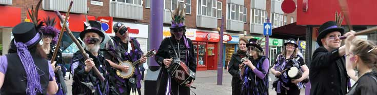Picture of us dancing in the Town Centre near the Sock Man, by Larry South
